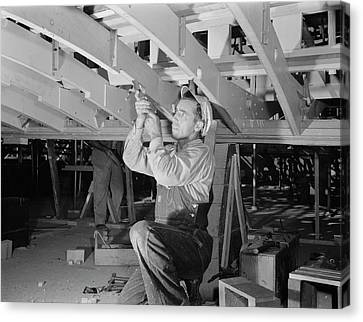 Man Working With A Chisel On A Beam Canvas Print