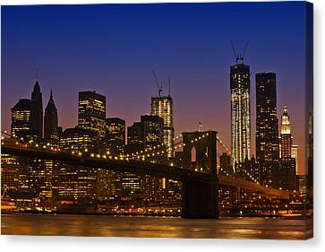 Manhattan By Night Canvas Print by Melanie Viola