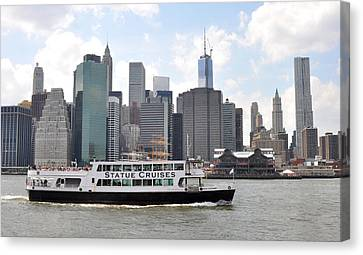 Manhattan Skyline With Boat Canvas Print by Diane Lent