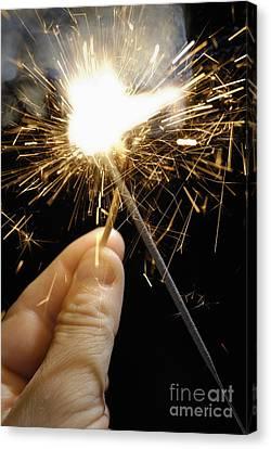 Man's Hand Igniting Sparkler Canvas Print