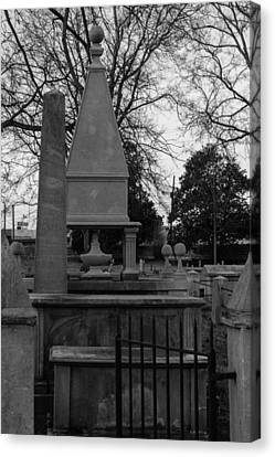 Many Tombstones Canvas Print by Robert Hebert
