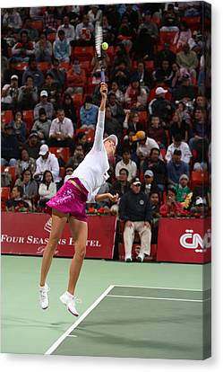 Maria Sharapova Serves In Doha Canvas Print by Paul Cowan
