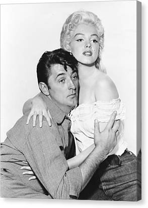 Marilyn Monroe And Robert Mitchum Canvas Print by Retro Images Archive