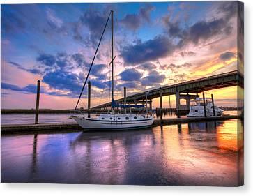Marina At Sunset Canvas Print by Debra and Dave Vanderlaan