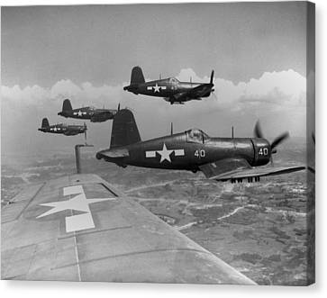 Marine Corsairs Fly On A Rocket Strike Canvas Print by Everett