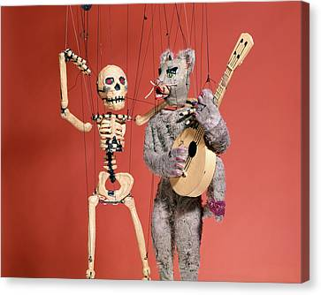 Marionette Canvas Print - Marionette Puppets A Skeleton And A Cat by Vintage Images