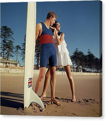 Marisa Berenson And Nat Young On A Beach Canvas Print