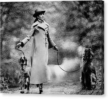 Marisa Berenson Walking Two Dogs Canvas Print