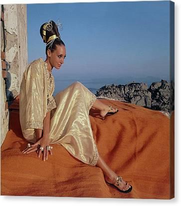 Marisa Berenson Wearing A Gold Caftan By Tina Canvas Print