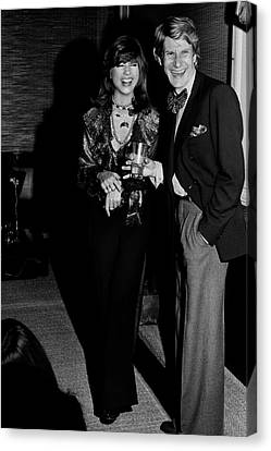 Mary Russell Laughing With Yves St. Laurent Canvas Print by Henry Clarke