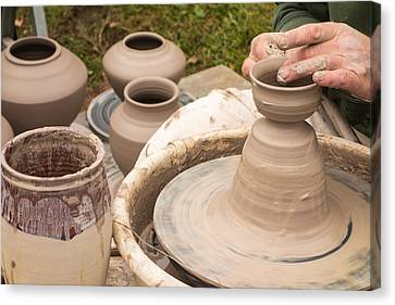 Master Potter Shaping Clay Canvas Print by Dancasan Photography