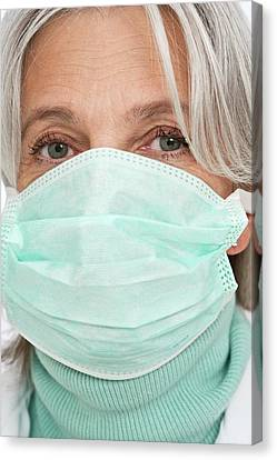Mature Female Doctor Wearing Surgical Mas Canvas Print