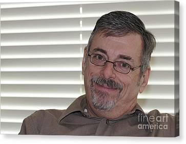 Mature Man Looking At Viewer Canvas Print by Lee Serenethos