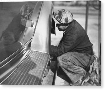 Mechanic Working On Car Canvas Print by Underwood Archives