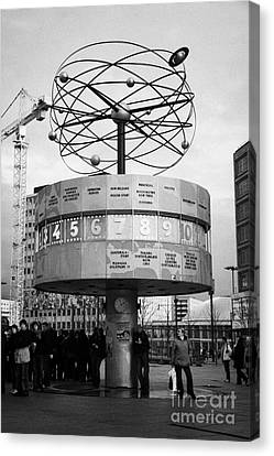 meeting place at the world clock Weltzeituhr at Alexanderplatz with reconstruction work in background east Berlin Germany Canvas Print by Joe Fox
