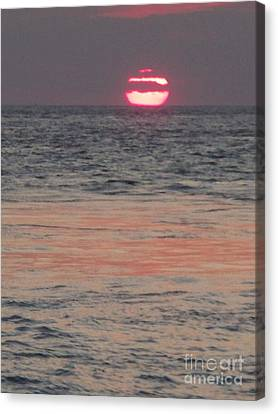 Melting Sun Into The Cool Sea Canvas Print by Eric  Schiabor