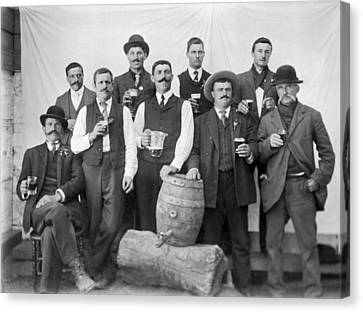 Men Around A Keg Of Beer Canvas Print by Underwood Archives