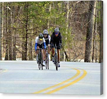 Men In A Bike Race Canvas Print by Susan Leggett