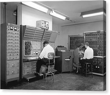 Men Working On Analog Computer Canvas Print by Underwood Archives