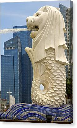 Merlion Statue By Singapore River Canvas Print by David Gn