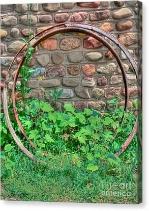 Metal Wheels Canvas Print by Kathleen Struckle