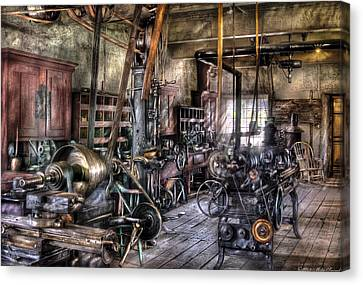 Metal Worker - Belts And Pullies Canvas Print by Mike Savad