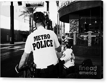 metro police bicycle cops in downtown Las Vegas Nevada USA Canvas Print by Joe Fox