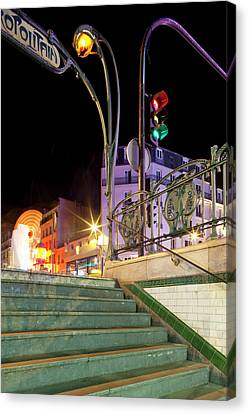 Metro Stop Lit Up At Night, Metro Canvas Print by Panoramic Images