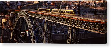 Metro Train On A Bridge, Dom Luis I Canvas Print by Panoramic Images