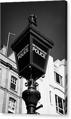 metropolitan police blue lamp sign outside a police station London England UK Canvas Print