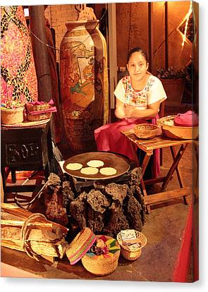 Mexican Girl Making Tortillas Canvas Print by Roupen  Baker