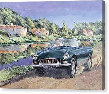 Mgb By A French Canal Canvas Print by Clive Metcalfe