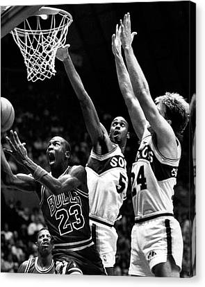 Michael Jordan Canvas Print - Michael Jordan Going For A Hard Layup by Retro Images Archive