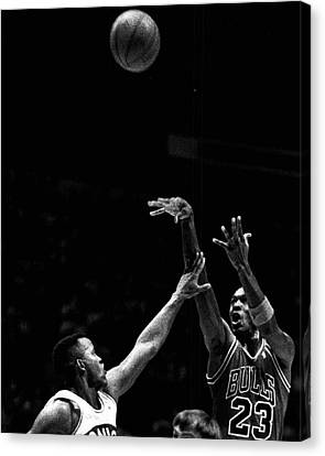 Michael Jordan Shooting Over Another Player Canvas Print