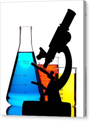Microscope In Laboratory Canvas Print by Jim Hughes