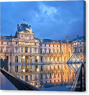 Midnight Reflection At The Louvre Canvas Print by Loriannah Hespe