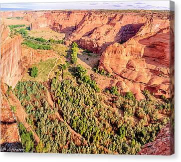 Miles To Go In Canyon De Chelly Canvas Print by Bob and Nadine Johnston