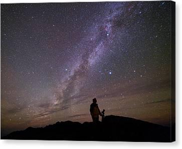 Milky Way And Photographer Canvas Print by Babak Tafreshi
