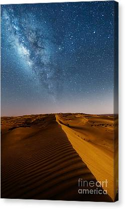 Milky Way Over Desert Dunes Canvas Print by Matteo Colombo