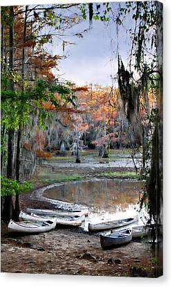 Canvas Print featuring the photograph Mill Pond Canoes by Lana Trussell