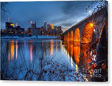 Minneapolis Skyline Images Stone Arch Bridge Spring Evening Canvas Print by Wayne Moran