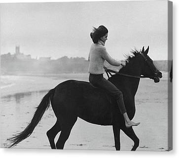 Minnie Cushing Riding A Horse Canvas Print by Toni Frissell