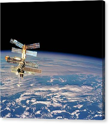 Mir Space Station From Space Shuttle Canvas Print by Nasa