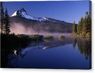 Mist Off Of Big Lake Canvas Print by Joe Klune