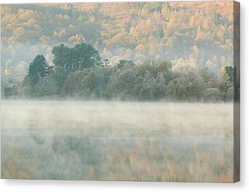 Mist Over Grasmere Canvas Print by Ashley Cooper