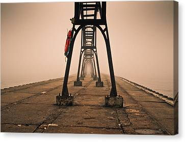 Canvas Print featuring the photograph Misty Pier by Jason Naudi Photography