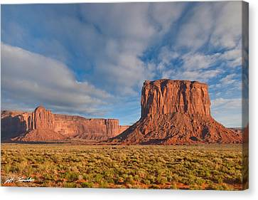 Canvas Print featuring the photograph Mitchell Butte And Gray Whiskers In The Evening Light by Jeff Goulden