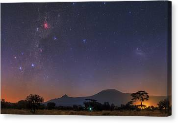 Mliky Way And Large Magellanic Cloud Canvas Print by Babak Tafreshi