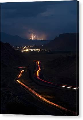 Moab Storm Canvas Print by Adam Romanowicz