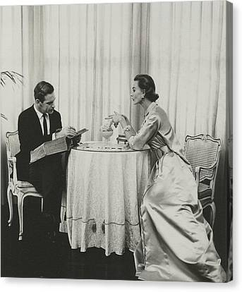 Model And Peter Pagan Looking At A Dictionary Canvas Print